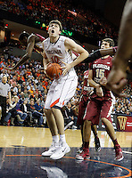 Virginia forward/center Mike Tobey (10) shoots the ball next to Florida State center Boris Bojanovsky (15) during the second half of an NCAA basketball game Saturday Jan. 18, 2014 in Charlottesville, VA. Virginia defeated Florida State 78-66. (AP Photo/Andrew Shurtleff)