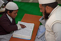Madrasa Student Reading the Koran for his Imam, Madrasa Imdadul Uloom, Dehradun, India.