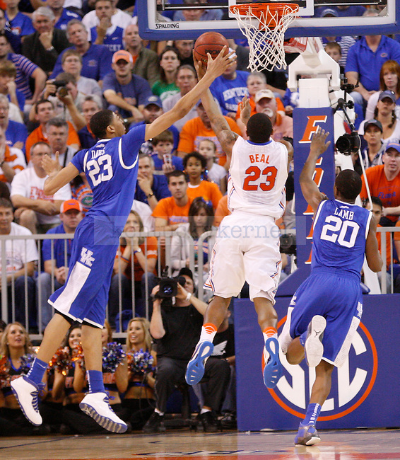 UK forward Anthony Davis attempts to block Florida's Bradley Beal's shot during the second half of the University of Kentucky's men basketball game against University of Florida on 3/4/12 at the O'Connell Center in Gainesville, Fl. Photo by Quianna Lige | Staff