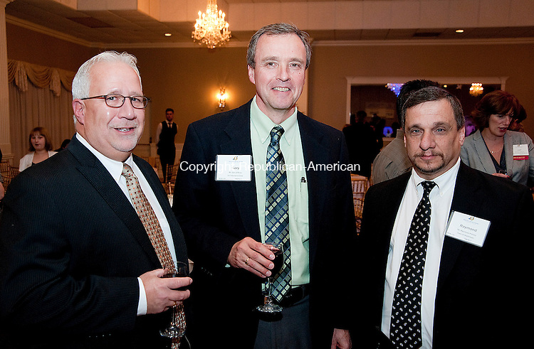 WATERTOWN- 110713JS14-Rich Dupont President, Resource Development Associates, left, Gary O'Brien Account Executive of ion Insurance Corp., center, and Ray Primini, Chairman of the Watertown Town Council, right, at the Watertown/Oakville Chamber of Commerce's 49th Annual Meeting and Awards Dinner at the Grand Oak Villa in Watertown.<br /> Jim Shannon Republican-American