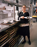 SPAIN, El Rioja, young waitress holding plate in the Echaurren kitchen