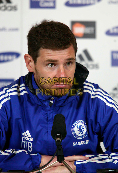 Andre Villas-Boas.Media conference to preview Norwich v Chelsea at Chelsea FC Training Ground, England..19th January 2012.headshot portrait blue jacket stubble facial hair half length microphone looks sad upset .CAP/DS.©Dudley Smith/Capital Pictures