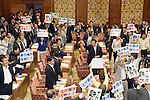 July 15, 2015, Tokyo, Japan - Opposition lawmakers holding protest signs as they try to obstruct proceedings during a vote on the government-sponsored security related bills in a Diet lower house special committee on national security in Tokyo on Wednesday, July 15, 2015. The committee voted to approve the bills with the support of the ruling Liberal Democratic Party and its junior coalition partner Komeito. The bills will be put to a vote in a Diet plenary session as early as July 16, after which it will be sent to the upper house. The bills, when enacted, will allow Japan to exercise its right to collective self-defense.  (Photo by Natsuki Sakai/AFLO) AYF -mis-