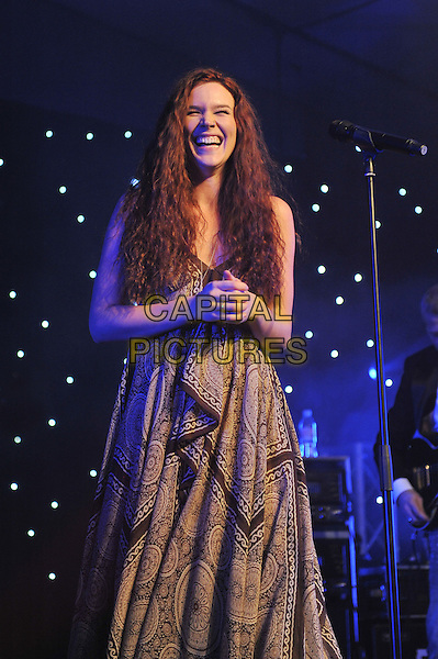 Joss Stone.'Global Angels Awards', The Park Plaza Hotel, Westminster, London, England. 2nd December 2011..music on stage live concert gig performing half length microphone   brown print scarf paisley dress smiling .CAP/MAR.© Martin Harris/Capital Pictures.