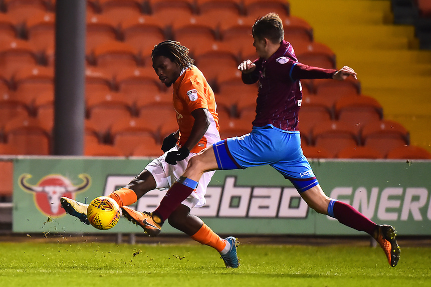 Blackpool's Dolly Menga competes with Scunthorpe United's Conor Townsend<br /> <br /> Photographer Richard Martin-Roberts/CameraSport<br /> <br /> The EFL Sky Bet League One - Blackpool v Scunthorpe United - Tuesday 26th December 2017 - Bloomfield Road - Blackpool<br /> <br /> World Copyright &not;&copy; 2017 CameraSport. All rights reserved. 43 Linden Ave. Countesthorpe. Leicester. England. LE8 5PG - Tel: +44 (0) 116 277 4147 - admin@camerasport.com - www.camerasport.com