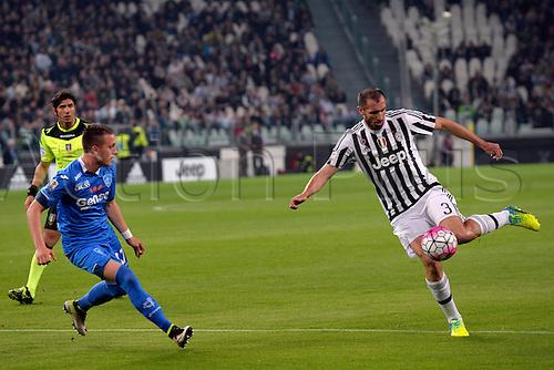 02.04.2016. Juventus Stadium, Turin, Italy. Serie A Football. Juventus versus Empoli. Giorgio Chiellini shoots as Raffaele Maiello covers