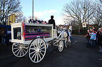 Dulwich fans applaud as the horse and carriage carrying the pink and blue coffin leaves the Stadium en route to the crematorium during the funeral of Dulwich Hamlet FC supporter Mishi Morath at Champion Hill Stadium on 15th January 2020