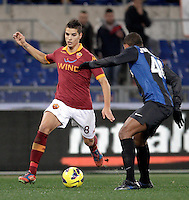 Calcio, semifinale di andata di Coppa Italia: Roma vs Inter. Roma, stadio Olimpico, 23 gennaio 2013..AS Roma forward Erik Lamela, of Argentina, is challenged by FC Inter defender Juan Jesus, of Brazil, right,  during the Italy Cup football semifinal first half match between AS Roma and FC Inter at Rome's Olympic stadium, 23 January 2013..UPDATE IMAGES PRESS/Riccardo De Luca