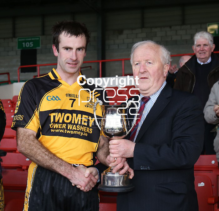 23/11/13 Clyda Rovers Captain Oliver O Hanlon is presented with the Cup By The Chairman of the Munster Council Robert Frost after the Munster Intermediate Final on Saturday. Pic Tony Grehan / Press 22