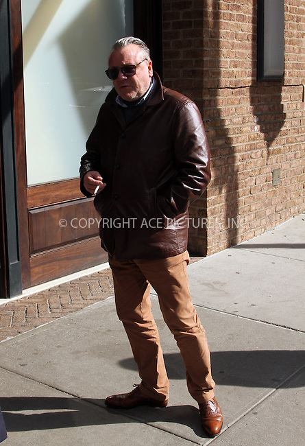 WWW.ACEPIXS.COM<br /> <br /> March 27 2014, New York City<br /> <br /> Actor Ray Winstone enjoys a smoke outside a downtown hotel on March 27 2014 in New York City<br /> <br /> By Line: Zelig Shaul/ACE Pictures<br /> <br /> <br /> ACE Pictures, Inc.<br /> tel: 646 769 0430<br /> Email: info@acepixs.com<br /> www.acepixs.com