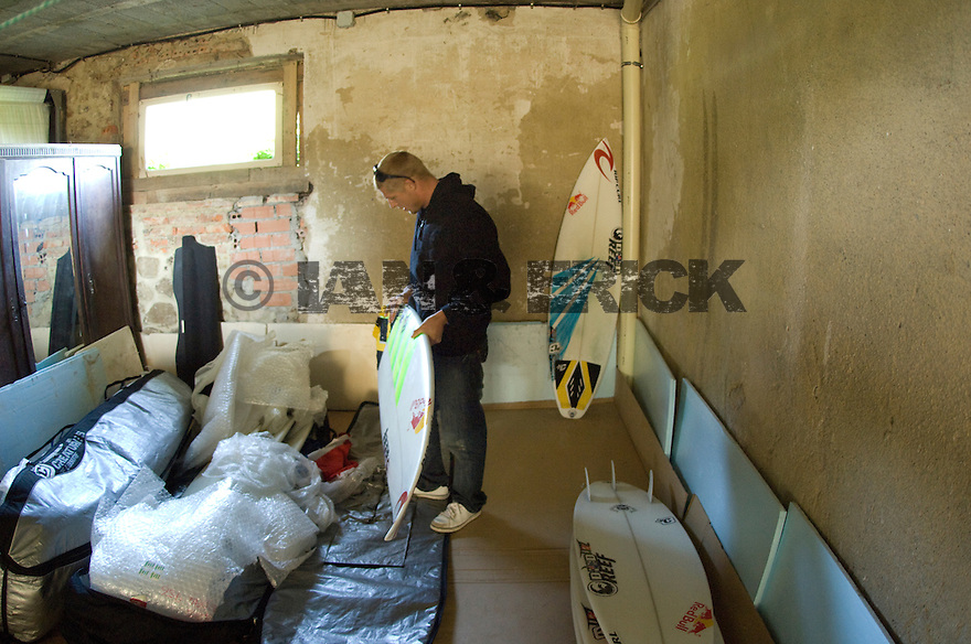 Mick Fanning sorting his boards in Bachio, Spain.