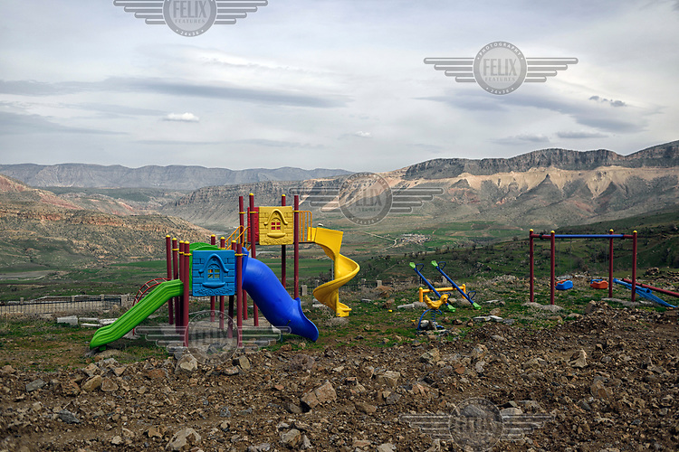 A new children's playground erected on a site prepared for buildings that will form the new village of Koctepe where the residents of the old village will move once the Ilusu hydroelectric dam is complete. The reservoir created by the dam will be approximately of 313 km2 (121 sq mi) and it will flood several villages and the town of Hasankeyf.