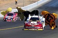 Jul. 27, 2013; Sonoma, CA, USA: NHRA funny car driver Tim Wilkerson (right) alongside Courtney Force during qualifying for the Sonoma Nationals at Sonoma Raceway. Mandatory Credit: Mark J. Rebilas-