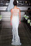 Model walks runway in a Yadira bridal gown from the Atelier Pronovias 2014 collection by Pronovias, at St. James' Church in New York City, on November 12, 2013.