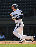 Designated hitter Zach Morton (14) of the Northwestern Wildcats hits in a game against the Michigan State Spartans on Sunday, February 17, 2013, at Fluor Field at the West End in Greenville, South Carolina. Michigan State won, 7-4. (Tom Priddy/Four Seam Images)