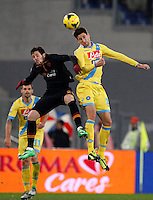 Calcio, semifinale di andata di Coppa Italia: Roma vs Napoli. Roma, stadio Olimpico, 5 febbraio 2014.<br /> AS Roma forward Mattia Destro, left, and Napoli defender Federico Fernandez, of Argentina, jump for the ball during the Italian Cup first leg semifinal football match between AS Roma and Napoli at Rome's Olympic stadium, 5 FeBruary 2014.<br /> UPDATE IMAGES PRESS/Riccardo De Luca