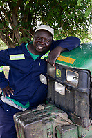 ZAMBIA, Mazabuka, Chikankata area, medium scale farmer Stephen Chinyama with his John Deere Tractor