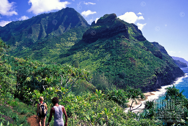 Hikers on the Kalalau trail see Hanakapiai  beach glistening ahead