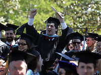A student from the college of Arts and Sciences cheers when his school is called during the 2006 Graduation ceremonies held Sunday May 21, 2006 at the University of Virginia in Charlottesville, Va. Photo/Andrew Shurtleff