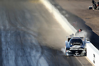 Feb. 23, 2013; Chandler, AZ, USA; NHRA funny car driver Cruz Pedregon hits the wall during qualifying for the Arizona Nationals at Firebird International Raceway. Mandatory Credit: Mark J. Rebilas-