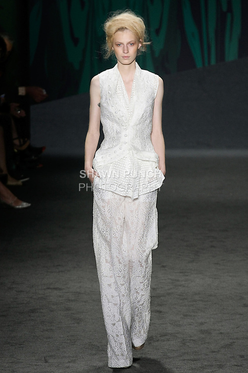 """Model walks the runway in an outfit from the Vera Wang Spring 2013 """"Out of India"""" collection, during Mercedes-Benz Fashion Week Spring 2013 in New York City."""