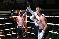 Jack Hughes (black/pink shorts) defeats Stefan Slavchev during a Boxing Show at York Hall on 8th June 2019