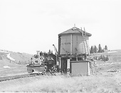 D&amp;RGW #499 with Rocky Mountain RR Club excursion at the Los Pinos water tank.<br /> D&amp;RGW  Los Pinos, CO  Taken by Richardson, Robert W.