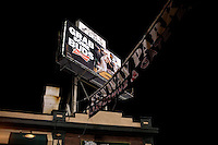"""A Budweiser Beer billboard reading """"Grab some Buds"""" features the Boston Red Sox outside Fenway Park in Boston, Massachusetts, USA."""