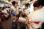 Kimono-clad 20-year-old Japanese women ride a train after a ceremony held for Coming-of-Age Day at Toshimaen amusement park in Tokyo, Japan on 14 January 2008. While Japanese women can marry as early as 16 years of age and men at 18, neither is considered to reach adulthood until they reach 20, when they can also legally begin to smoke, drink and vote.COMING OF AGE
