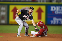 Jupiter Hammerheads shortstop Justin Bohn (13) tags Carlos Tocci (19) sliding into second during the second game of a doubleheader against the Clearwater Threshers on July 25, 2015 at Bright House Field in Clearwater, Florida.  Clearwater defeated Jupiter 2-1.  (Mike Janes/Four Seam Images)