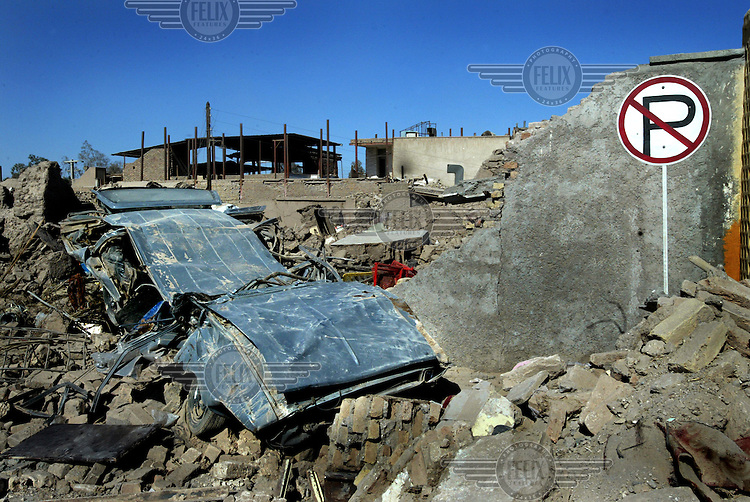 A car crushed by collapsing houses in the Bam earthquake..An earthquake measuring 6.3 on the Richter scale caused widespread devastation in the ancient city of Bam and other parts of Kerman Province, leaving at least 30,000 people dead.