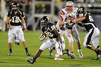 6 December 2008:  FIU running back Darriet Perry (28) breaks into the Western Kentucky secondary during the third quarter of the FIU 27-3 victory over Western Kentucky at FIU Stadium in Miami, Florida.