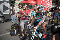 A badly bruised Jean-Christophe Péraud (FRA/Ag2r-La Mondiale) is rushed to the teambus after finishing. <br /> He left a lot of skin on the searing hot tarmac after crashing earlier in the stage.<br /> <br /> stage 13: Muret - Rodez<br /> 2015 Tour de France