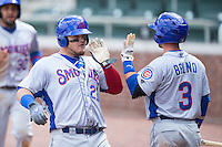 Dan Vogelbach (21) of the Tennessee Smokies high fives teammate Stephen Bruno (3) after hitting a sacrifice fly in the top of the 13th inning against the Birmingham Barons at Regions Field on May 4, 2015 in Birmingham, Alabama.  The Barons defeated the Smokies 4-3 in 13 innings. (Brian Westerholt/Four Seam Images)