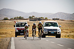 SULAIMANIYAH, IRAQ: Members of Newroz cycling club compete in team time trials in temperatures of over 30&ordm;C.  One of the team, Lavan, had a puncture and had to fall back and fix it before completing the time trial. Nyan Yassin is far left.<br /> <br /> Nyan Yassin, 24, is a professional competitive cyclist in Sulaimaniyah in the semi-autonomous region of Iraqi Kurdistan.  She is the captain of an all-female club called Newroz Club, which is the only cycling club for women in Sulaimaniyah, although there are other clubs around Iraq.  She trains and competes on roads that are badly surfaced and busy with traffic.<br /> <br /> Nyan was the first woman to start cycling in Sulaimaniyah.  She was always competitive and after trying her hand at different sports she settled on cycling.  She is now the top female cyclist in Iraq.  Her nickname is MigMig after the noise made by the cartoon character Roadrunner.<br /> <br /> Despite being clearly talented at her sport Nyan knows that in a couple of years she will have to get married and then abandon it as, in the traditional society that Kurdistan is, being a wife and a competitive sportswoman at the same time is not an option.<br /> <br /> Photo by Gona Hassan/Metrography