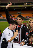 Jamie Moreno (99) of D.C. United, with his son James,  waves to the assembled crowd after his last game at RFK Stadium in Washington, DC.  Toronto defeated D.C. United, 3-2.