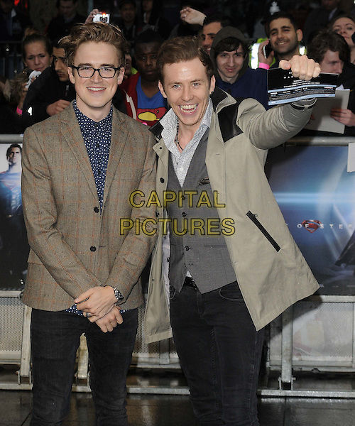 Tom Fletcher &amp; Danny Jones of McFly<br /> 'Man Of Steel' UK film premiere, Empire cinema, Leicester Square, London, England.<br /> 12th June 2013<br /> half length brown grey gray suit jacket waistcoat hand arm<br /> CAP/CAN<br /> &copy;Can Nguyen/Capital Pictures