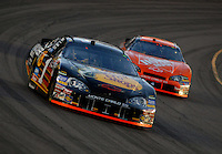 Apr 22, 2006; Phoenix, AZ, USA; Nascar Nextel Cup driver Martin Truex Jr. of the (1) Bass Pro Shops Chevrolet Monte Carlo leads Tony Stewart during the Subway Fresh 500 at Phoenix International Raceway. Mandatory Credit: Mark J. Rebilas-US PRESSWIRE Copyright © 2006 Mark J. Rebilas..