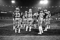 SAN FRANCISCO, CA - Jerry Rice and Roger Craig of the San Francisco 49ers stand in a huddle with teammates during a game against the Los Angeles Rams at Candlestick Park in San Francisco, California in 1988. Photo by Brad Mangin