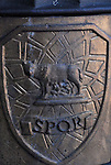 "SPQR is an initialism from a Latin phrase,Senatus Populusque Romanus (""The Senate and People of Rome""'referring to the goverment of the the ancient Roman Republic,and used as an official emblem of the modern municipality of Rome. It is inscribed in stone or metal, in dedications of monuments and public works,and was emblazoned on the standards of the Roman legions. Above the inscription is Romulus and his twin Remus being suckled by a she wolf."