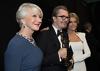 Gary Oldman poses backstage with Helen Mirren and Jane Fonda with the Oscar&reg; for performance by an actor in a leading role, for work on &ldquo;Darkest Hour&rdquo; during the live ABC Telecast of The 90th Oscars&reg; at the Dolby&reg; Theatre in Hollywood, CA on Sunday, March 4, 2018.<br /> *Editorial Use Only*<br /> CAP/PLF/AMPAS<br /> Supplied by Capital Pictures