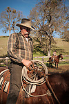 Doug Joses and Mattley Dell'Orthod at the Dell'Orto outfit branding, doctoring and marking cattle during a clear day in the Sierra Nevada Foothills, Amador County, Calif.
