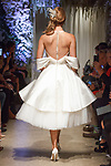 """Model walks runway in a bridal gown from the Matthew Christopher 2018 """"Perennial Bliss"""" collection at 325 West 38 Street on October 7, 2017 during New York Bridal Fashion Week."""