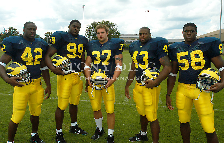 Michigan football linebackers Lawrence Reid, Pierre Woods, Brian Lafer, Carl Diggs, and Roy Manning post for a portrait during the annual Michigan Football Media Day at Schembechler Hall on Saturday, August 9, 2003 (TONY DING/Daily).