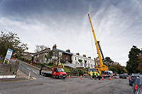 Contractors examine the damage to a property that lost its front wall after heavy rain on Ffynone Road in Swansea, Wales, UK. Wednesday 30 October 2019