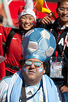 A South Korea and Argentina fan have their photo take together outside Soccer City in Johannesburg, South Africa on Thursday, June 17, 2010 before Argentina's and South Korea FIFA World Cup first round match.