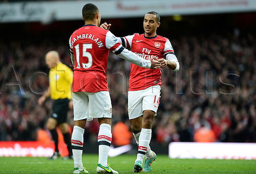 17.11.2012. London, England.  Theo Walcott Of Arsenal  celebrates scoring with Alex Oxlade-Chamberlain Of Arsenal who provided the assist during the Premier League game between Arsenal and Tottenham Hotspur from the Emirates Stadium.....