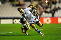 Geoffrey Palis of Castres Olympique is tackled by Marland Yarde of Harlequins during the European Rugby Champions Cup  Round 1 match between Harlequins and Castres Olympique at the Twickenham Stoop on Friday 17th October 2014 (Photo by Rob Munro)