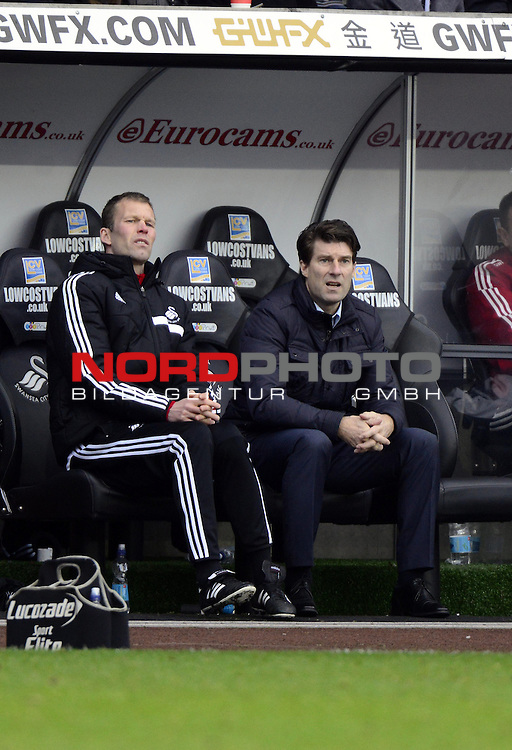 Swansea City Manager, Michael Laudrup watches from the bench -   19/01/2014 - SPORT - FOOTBALL - Liberty Stadium - Swansea - Swansea City v Tottenham Hotspur - Barclays Premier League<br /> Foto nph / Meredith<br /> <br /> ***** OUT OF UK *****