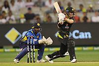 1st November 2019; Melbourne Cricket Ground, Melbourne, Victoria, Australia; International T20 Cricket, Australia versus Sri Lanka; David Warner of Australia plays the ball through the off side - Editorial Use